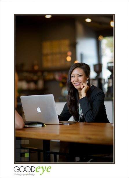 business portrait of attractive asian businesswoman talking on a phone in a coffeeshop