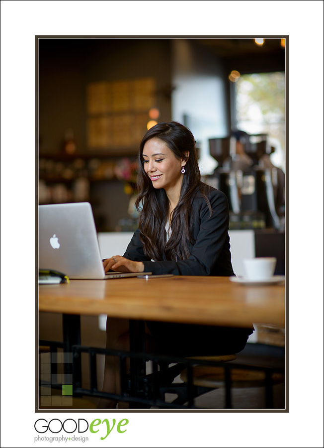 business portrait of attractive asian businesswoman using a laptop in a coffeeshop