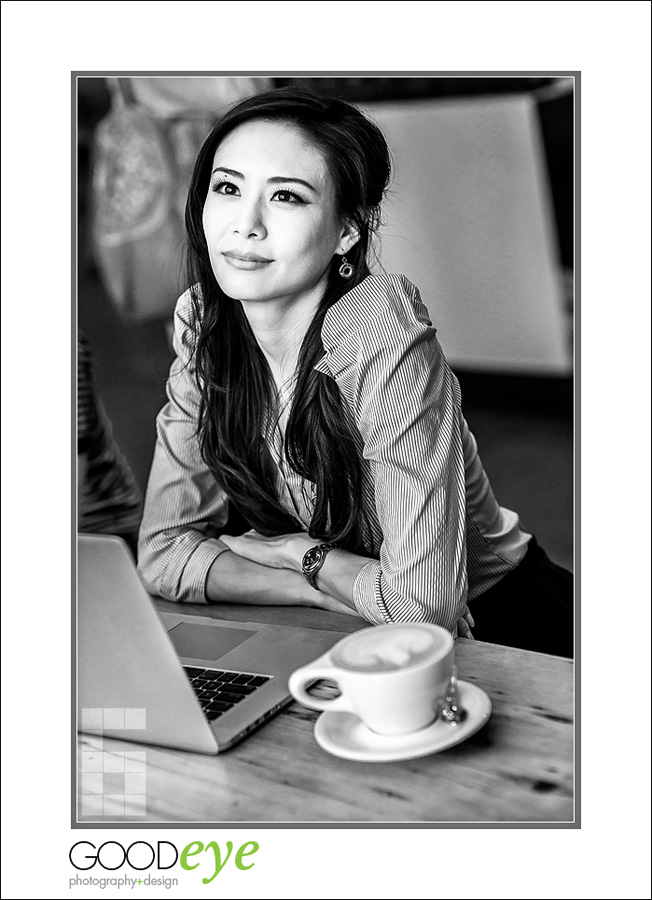 business portrait of attractive asian businesswoman thinking in a coffeeshop